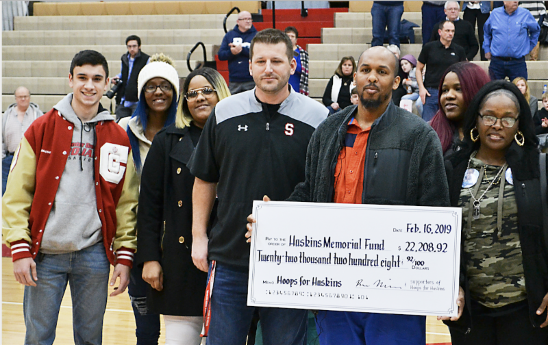CGHS Senior presents check to Southport family