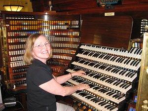 Esther Kovaks playing pipe organ